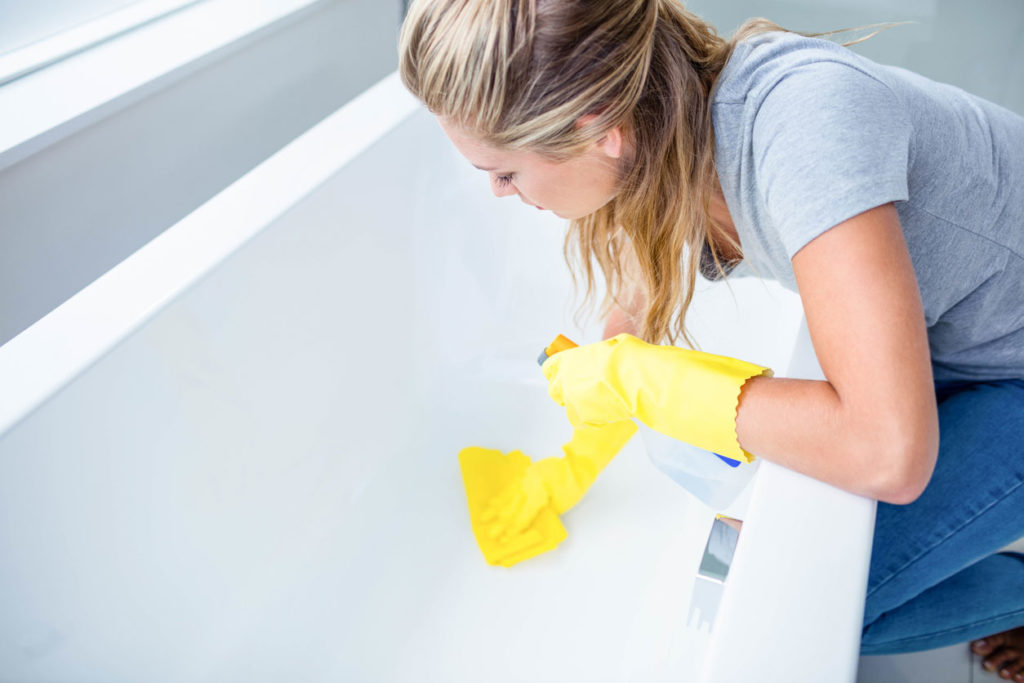Woman cleaning a tub