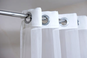 Shower curtain hanging on a shower rod
