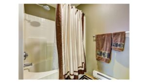where to hang shower curtain